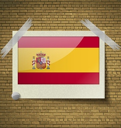 Flags Spainat frame on a brick background vector image