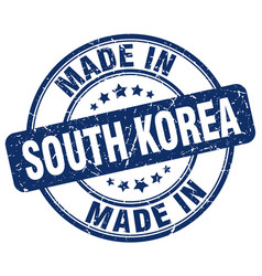 made in south korea blue grunge round stamp vector image