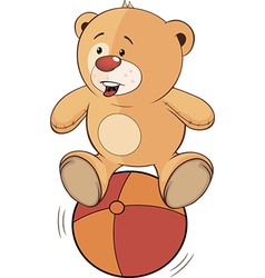 A stuffed toy bear cub and a ball vector image