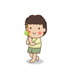 Buddhist boy walking with lighted candle in hand vector