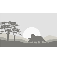 Silhouette of triceratops with fog scenery vector