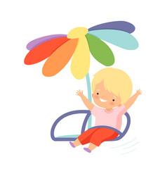 Cute happy kid swinging at carousel happy boy vector