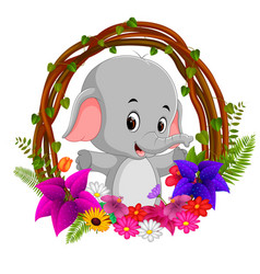 cute elephant in root of tree frame with flower vector image