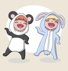 Cute children wearing a rabbit and panda costume vector