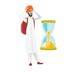 Worried hindu traveler man looking at hourglass vector