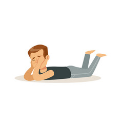 Frustrated boy character lying on his stomach on vector