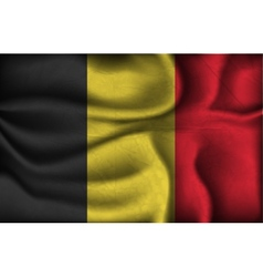 crumpled flag of Belgium on a light background vector image