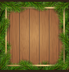 pine tree branches frame on wooden background vector image