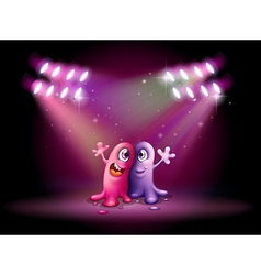 Two one-eyed monsters at the centerstage vector image