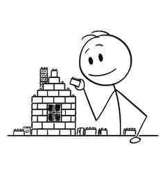 Cartoon of boy man or businessman building house vector