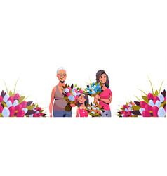 Happy three generations women holding bouquet vector