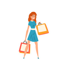 smiling redheaded woman with shopping bags girl vector image