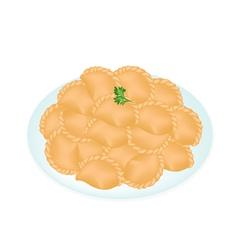 A Dish of Mini Thai Curry Puffs vector image
