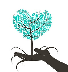 Heart Shaped Tree in Human Hand Silhouette vector image