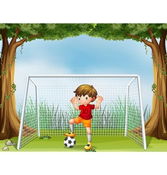 A little soccer player in his red uniform vector image