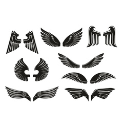Black tribal heraldic wings set vector image