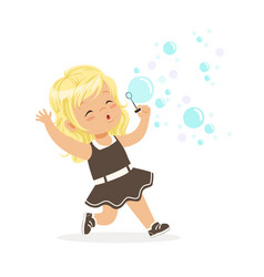 Cute blonde little girl blowing bubbles vector