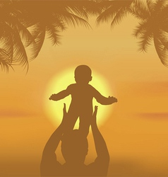 father and the son playing on a beach vector image