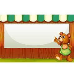 A bear beside the empty template vector image