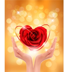 Love concept holding a red heart in hands vector image