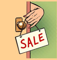 sale woman hand hangs a sign on the door vector image