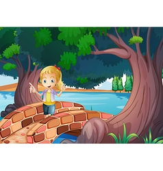 A girl at the bridge near the giant trees vector image