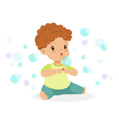 adorable little boy sitting blowing bubbles vector image