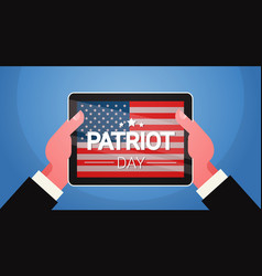 Hands hold tablet computer with united states flag vector