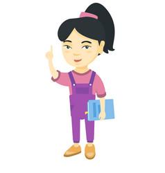 Little asian schoolgirl pointing forefinger up vector