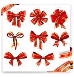 Set of red and gold gift bows with ribbons vector