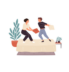 Adorable woman friends playing pillow fight on bed vector