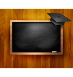 Blackboard with graduation cap vector image