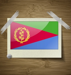 Flags Eritrea at frame on wooden texture vector image