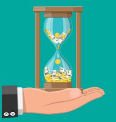 Money with hourglass clock in hand vector