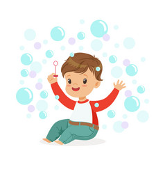 smiling little boy sitting on the floor and vector image