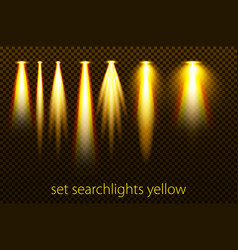 Set of yellow searchlights on a transparent vector