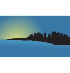 Silhouette of city at sunset in the beach vector
