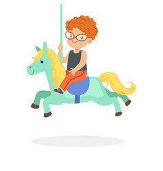 cute little redhead boy riding on the carousel vector image vector image