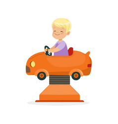 cute blonde little boy riding on an orange car vector image
