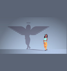 Cute african american girl with shadow angel vector