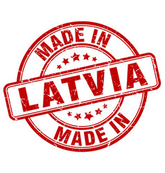 Made in latvia red grunge round stamp vector