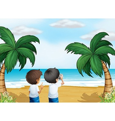 Two photographers at the beach vector image