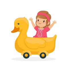 Cute little girl riding on yellow duck kid have a vector