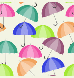 A seamless pattern with open umbrellas vector