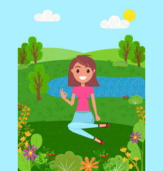 Young smiling girl sits on a grass and shows okay vector