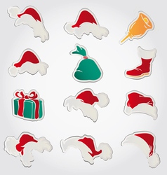 Set of red santa hats and clothing and christmas vector