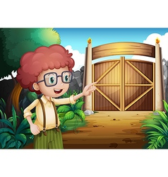 A smart looking young boy inside the gate vector image