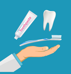 Dentist hand with a toothbrush and toothpaste vector