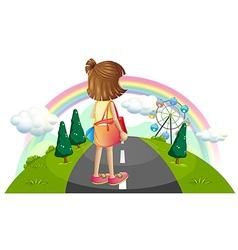 A young girl standing in the middle of the street vector image