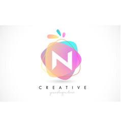 N letter logo design with vibrant colorful splash vector
